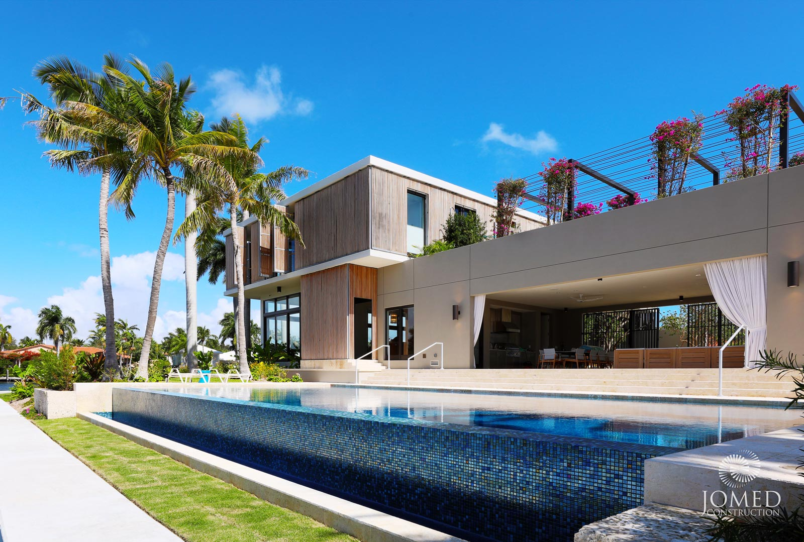 This twenty-first century estate dares to reimagine modern architecture with an enchanting rooftop garden overlooking the property's private marina dock on the Atlantic Intracoastal. The numerous window-lit spaces in this sophisticated abode offer a picturesque view of either the Mediterranean-style swimming pool or the artistic, front-yard garden.